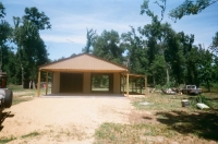 30x30x10, 20\' extended roof line, 12\' lean-to. Saddle tan walls, frost white roof, Cocco brown trim.