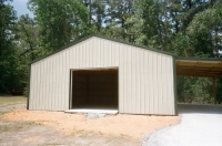 30x40x10, 12' lean-to. light stone walls fern green roof and trim.