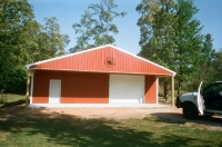 30x40x10, 10' extended roof line, rustic red walls white trim and roof